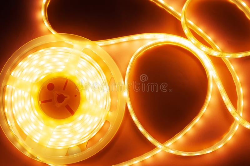 Silicone diode tape for lighting decorative corners and niches, LED light coil. Close-up stock photography