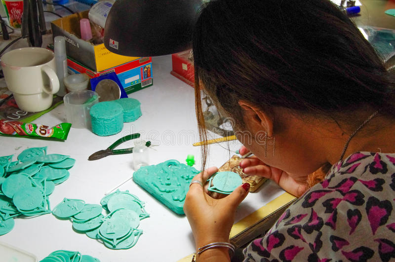 Silicone Rubber Moulds - Thailand - woman. Thailand: young woman works in a factory stock photo