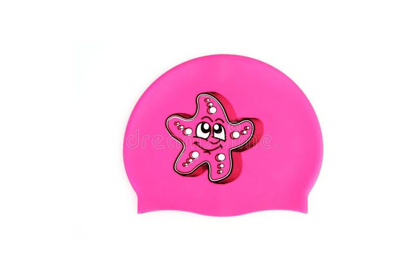 Silicone swim cap isolated on white. Bright crimson baby swim cap isolated on white background stock photo
