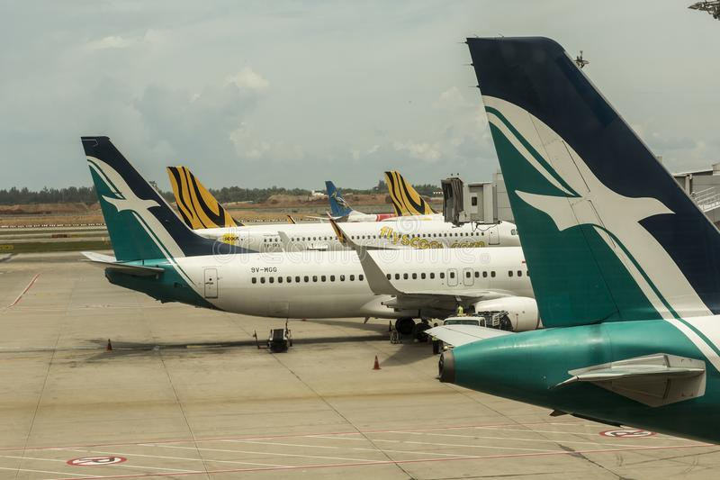 Silk Air airline with the bird sign at the tail. SilkAir Singapore is a regional airline with its head office in Airline House in Singapore previously it was on royalty free stock image
