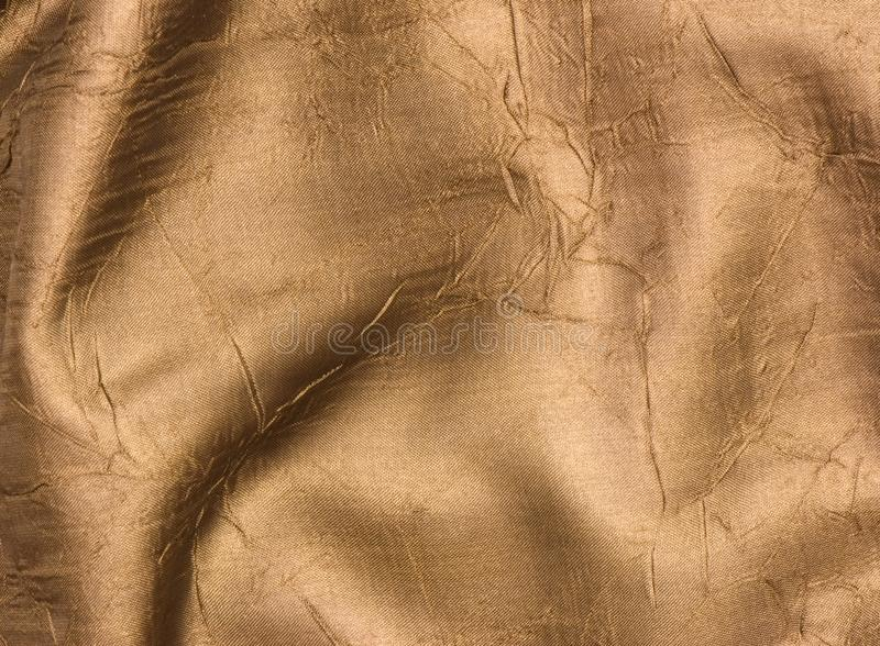 Silk background. Luxurious deep satin/silk folded fabric, useful for backgrounds royalty free stock photography