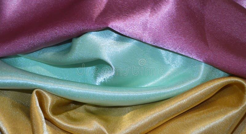 Silk background blue pink golden. Silk background blue  golden pin pink royalty free stock images