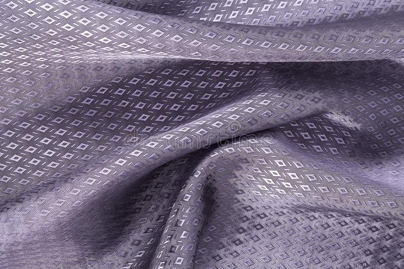 Silk background, texture of violet, diamond patern shiny fabric. Close up royalty free stock images