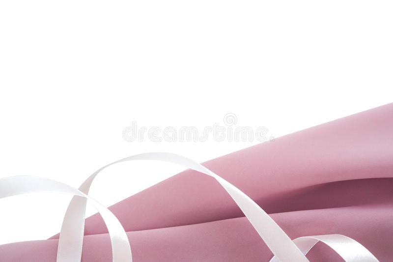 Silk beige folded fabric with tender-pink ribbon background. Use for banner design for fabric stores, tailoring shops and stores o. F women`s and children`s royalty free stock images