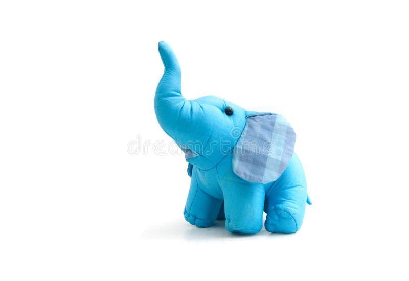 Silk blue elephant toy. On white royalty free stock photos