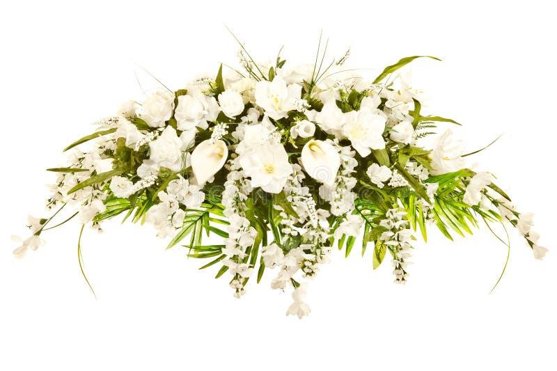 Silk casket cover funeral floral arrangement royalty free stock photos