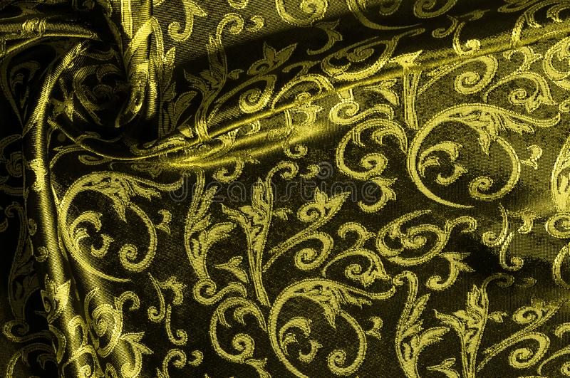 Silk cloth Royal monogram. Yellow is dark. This is a black silk. Velvet with a royal gold seal, creating a negative space patterned picture. Light weight, great stock illustration