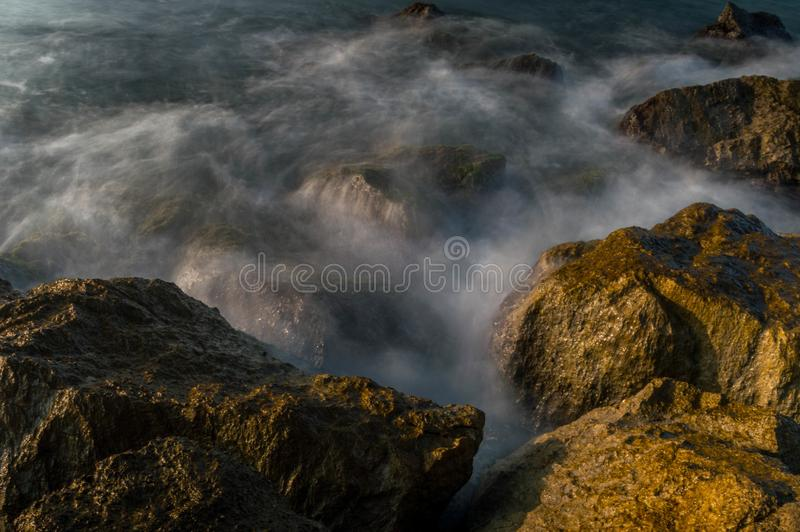 Silk effect photography on some rocks stock images
