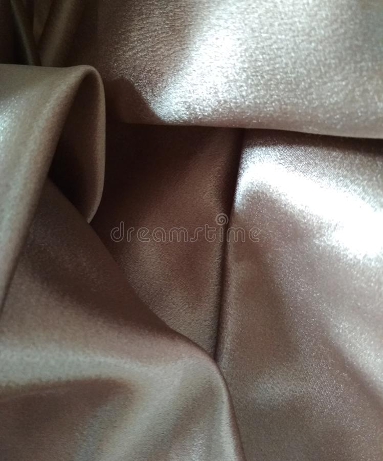 Silk elegant satin texture champagne stock photography