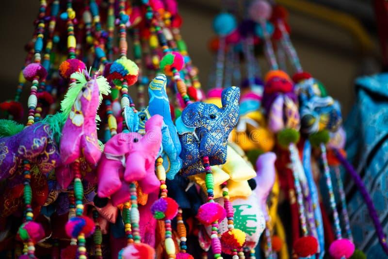 Silk elephant and animal charms. Colorful silk elephant and animal charms hanging for sale in Krabi stock photo