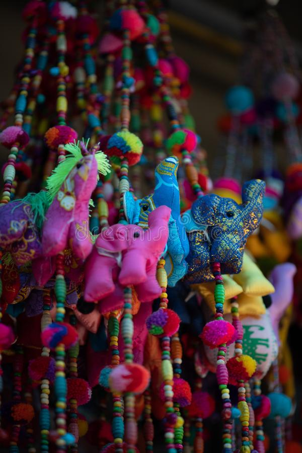 Silk elephant and animal charms vertical. Colorful silk elephant and animal charms hanging vertically for sale in Krabi stock photos