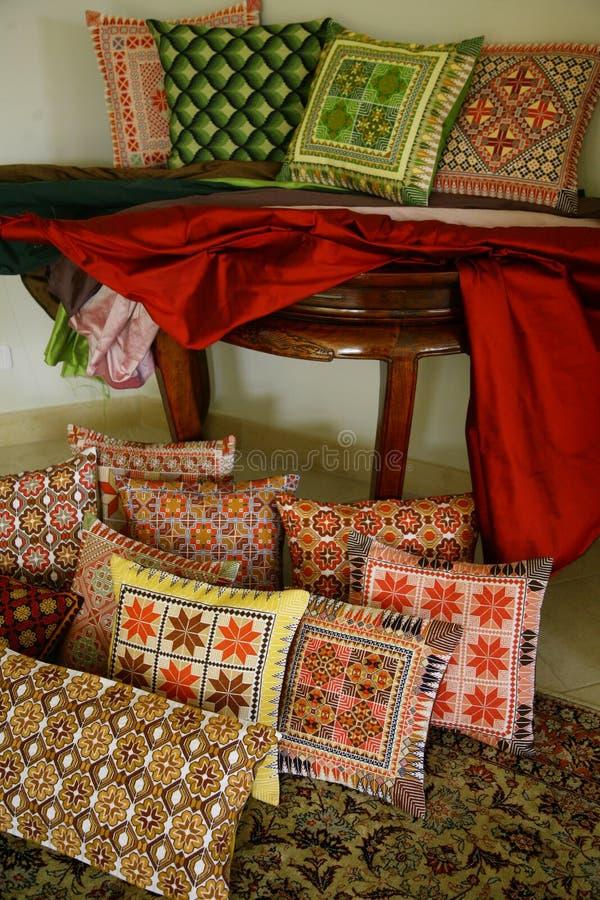 Silk Embroidered Arabian Art. Handmade Arabian silk embroidered Bedouin pillows and silk cloth royalty free stock photos