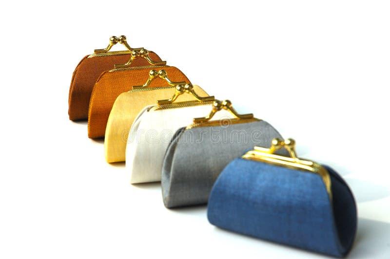 silk färgrika handväskor för mynt royaltyfri foto