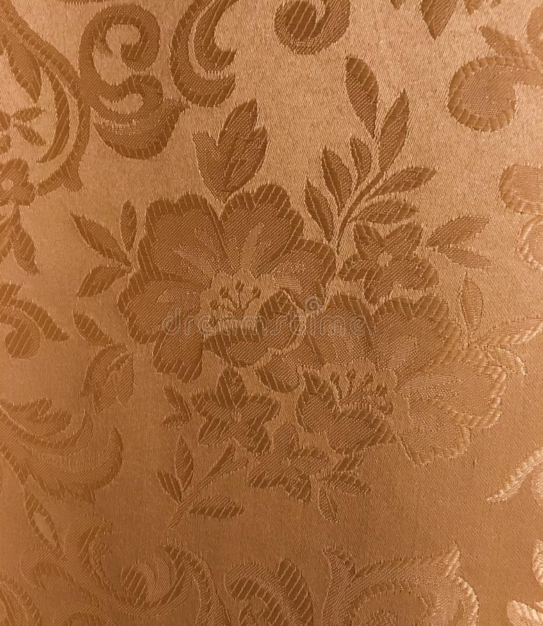 Silk flower fabric texture background. Gold silk fabric background wallpaper royalty free stock photo