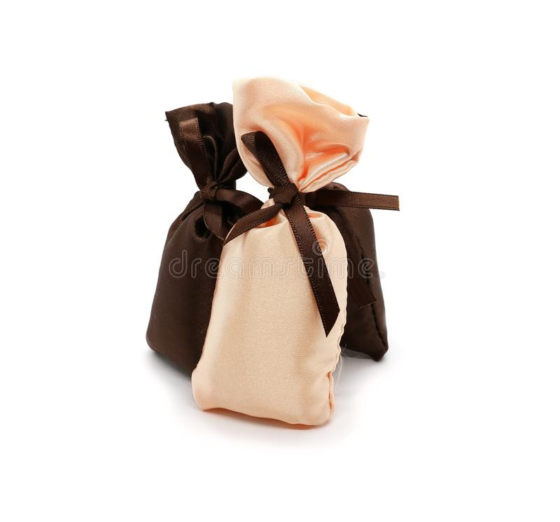Silk gift bags with bow isolated on white royalty free stock photo