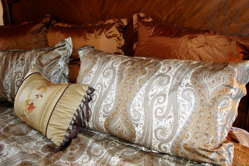 Silk Paisley Pillows. Beautiful silk paisley pillows in rich colors royalty free stock photos