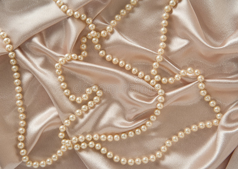 Silk & Pearls. Can be used as a backdrop royalty free stock photos