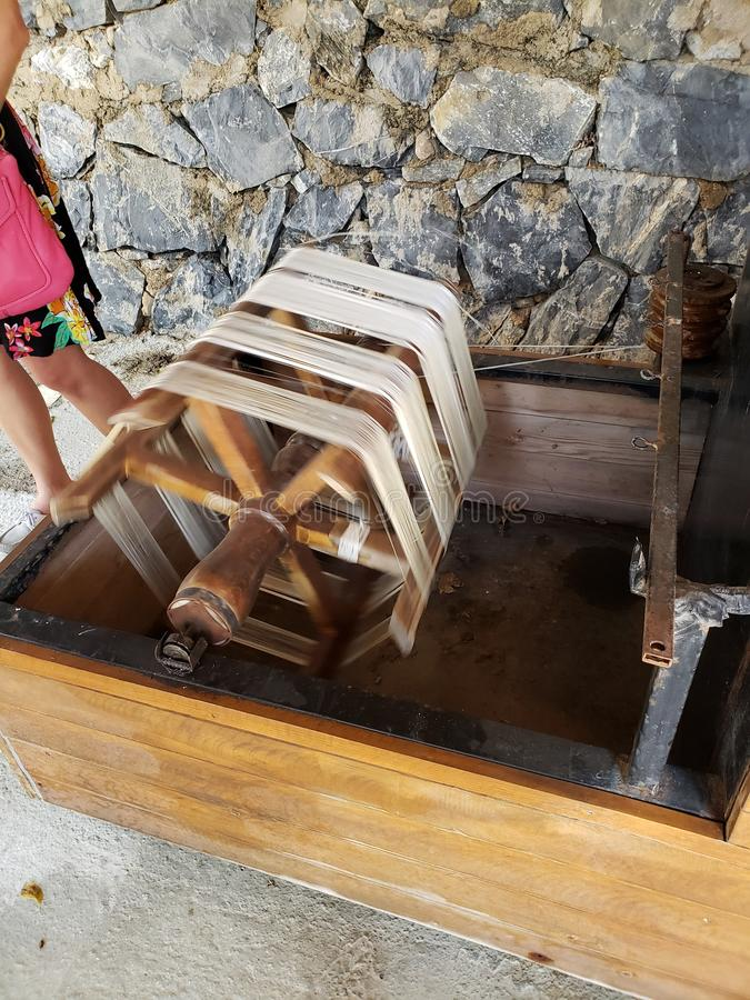 Silk spindle used in Kusadasi, Turkey. This silk spindle is still used today in Kusadasi, Turkey, to create thread for hand-made Turkish rugs royalty free stock photography