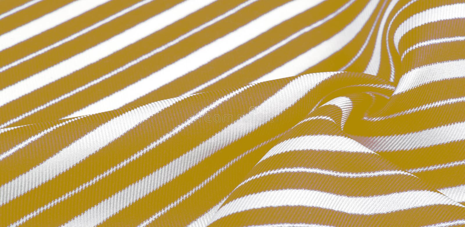 silk striped fabric. yellow white stripes. This beautiful, super soft, medium-sized silk blend is perfect for your design projects stock image