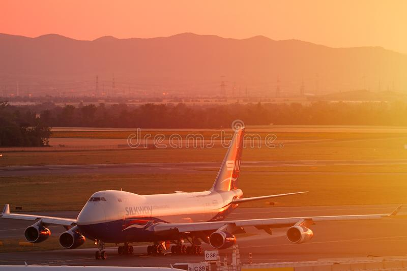 Silk Way Airlines plane taxiing at sunset, orange sky stock images