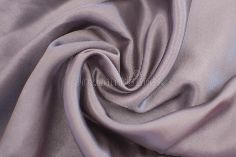 Silk wrinkled gray fabric. View from above. stock images