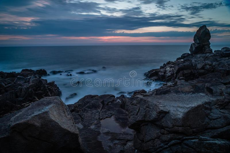 Silky ocean in La Torche in Brittany, France royalty free stock photography
