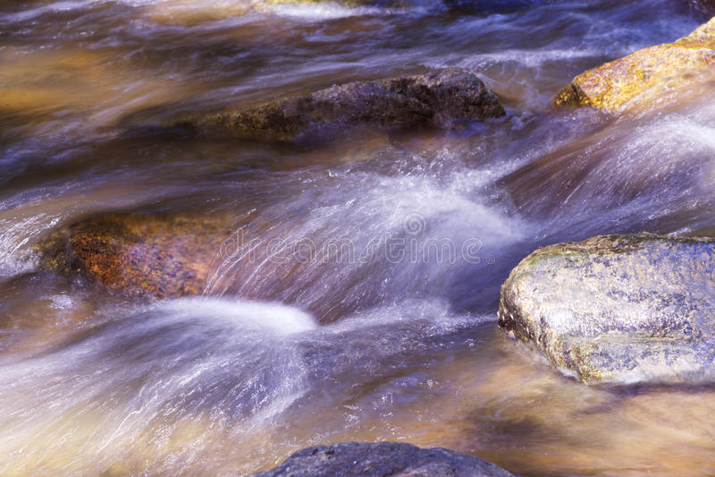 Silky rush of Raritan River waters at Ken Lockwood Gorge. Picturesque and silky rush of river water over boulders at scenic Ken Lockwood Gorge in New Jersey' royalty free stock images