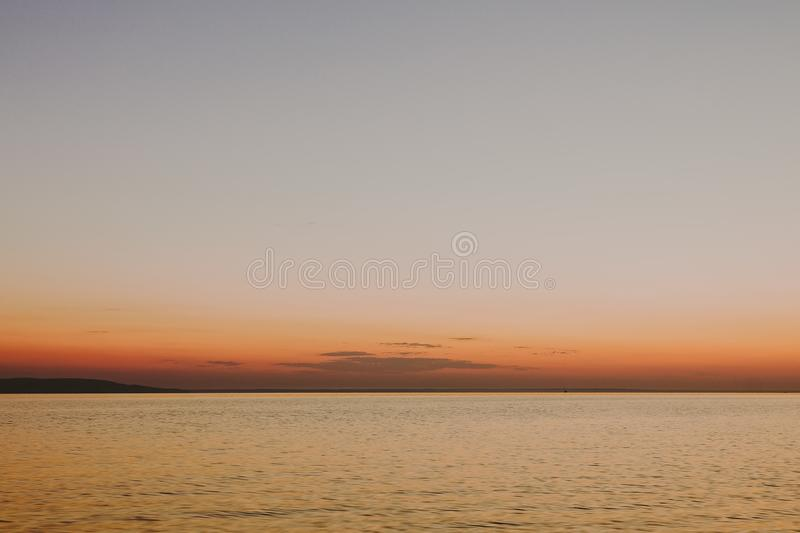 Silky smooth water with sunset in background royalty free stock photo