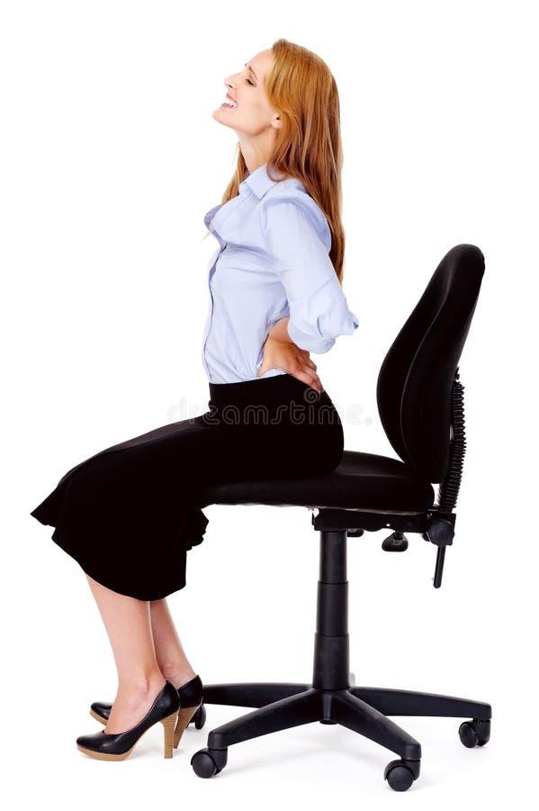 Silla de la oficina del dolor de espalda imagen de archivo libre de regalías