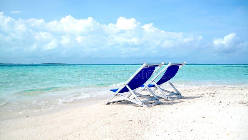 Silla en la playa fotografía de archivo
