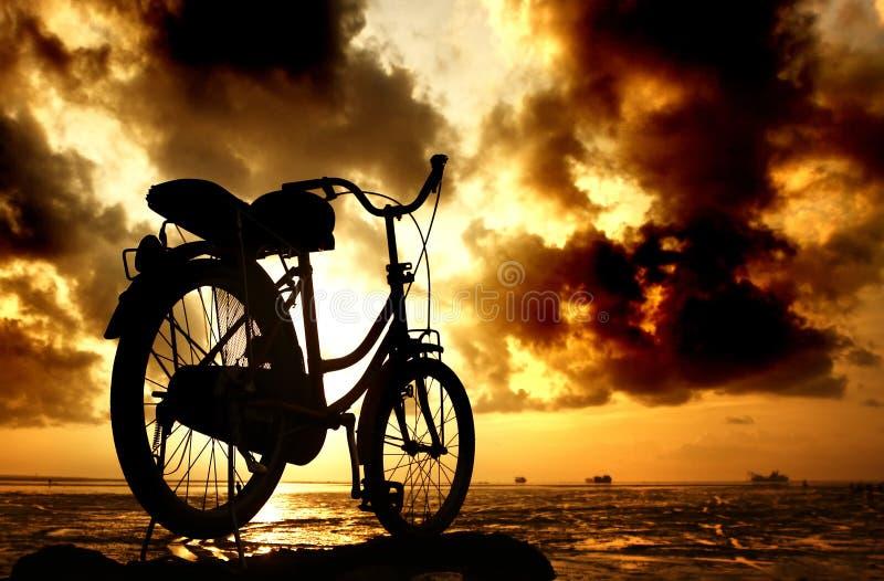 Sillhouette of bicycle at cloudy morning. Taken at Kenjeran beach, Surabaya, east Java, Indonesia stock photos