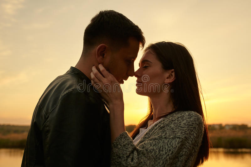 Sillhouette of young couple in love royalty free stock image