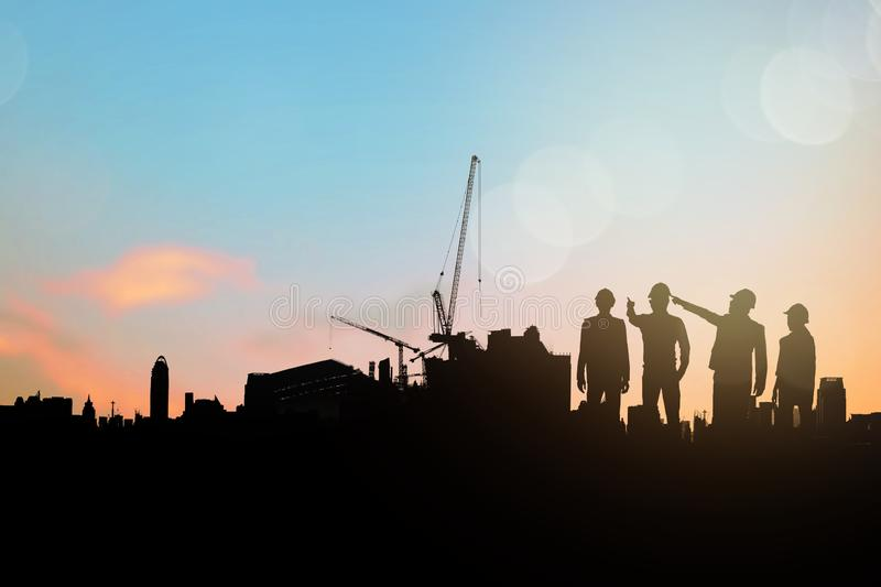 sillouette of engineer and building contractor group planning and survey space of construction royalty free stock photos