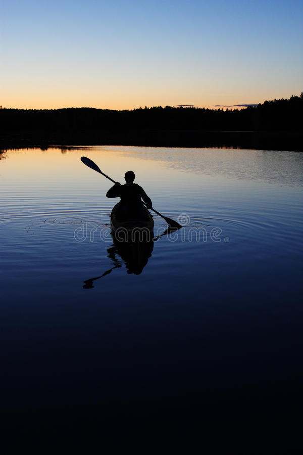 Download Sillouette Of Man Kayaking On Lake Stock Image - Image: 20141453
