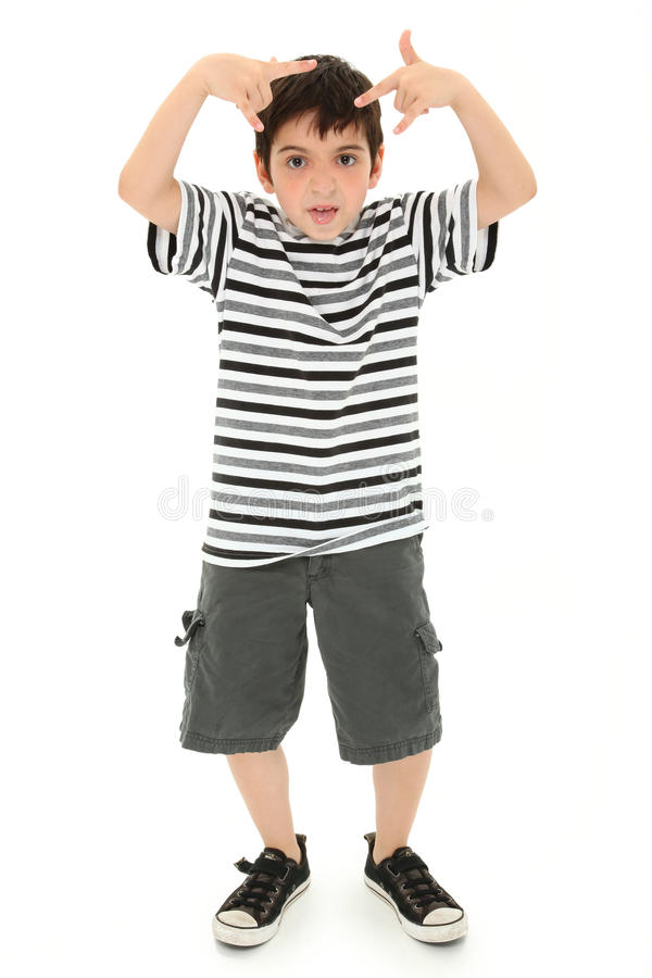 Silly Boy Making Goofy Faces and Gestures. Adorable 8 year old boy making silly faces and gestures over white background royalty free stock photos