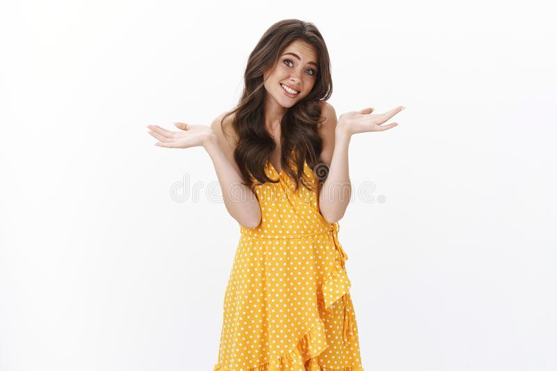 Silly cute glamour girl say oops, acting flirty and clueless, shrugging spread hands sideways smiling lovely, make stock image