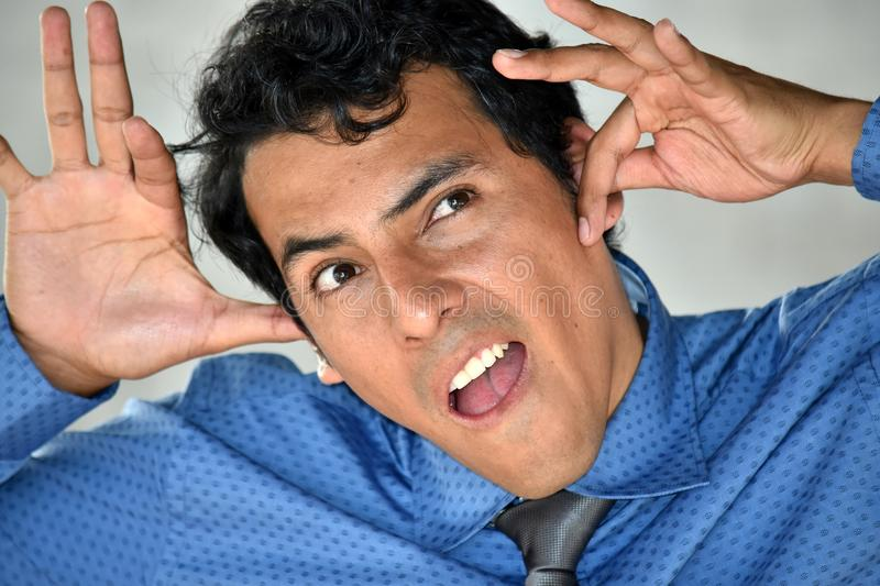 Silly Diverse Business Man Wearing Tie. A handsome adult hispanic man stock photos