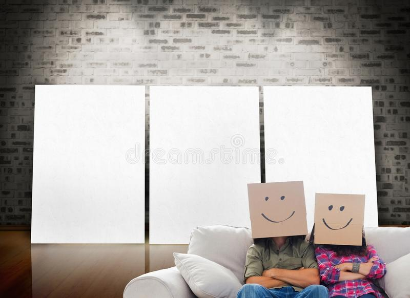 Silly employees with arms folded wearing boxes on their heads royalty free stock photos