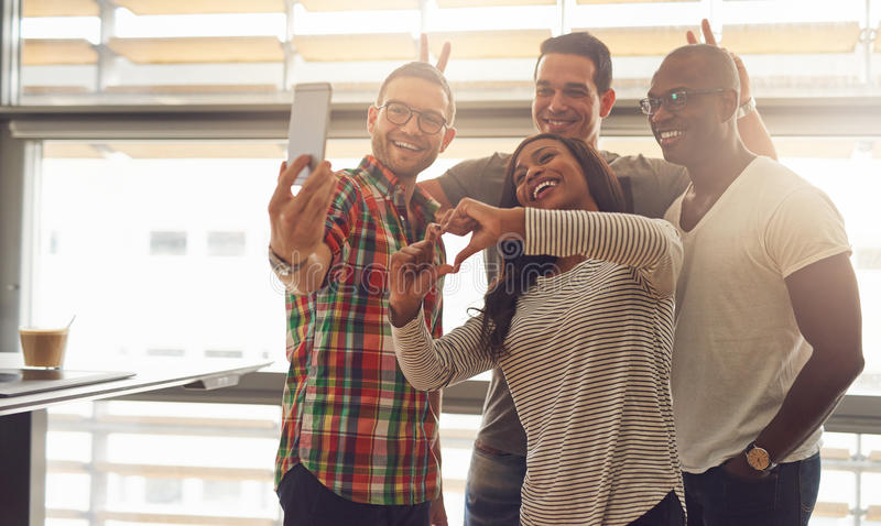 Silly employees taking self portrait royalty free stock photo