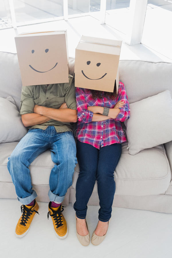 Silly employees wearing boxes on their heads royalty free stock photography