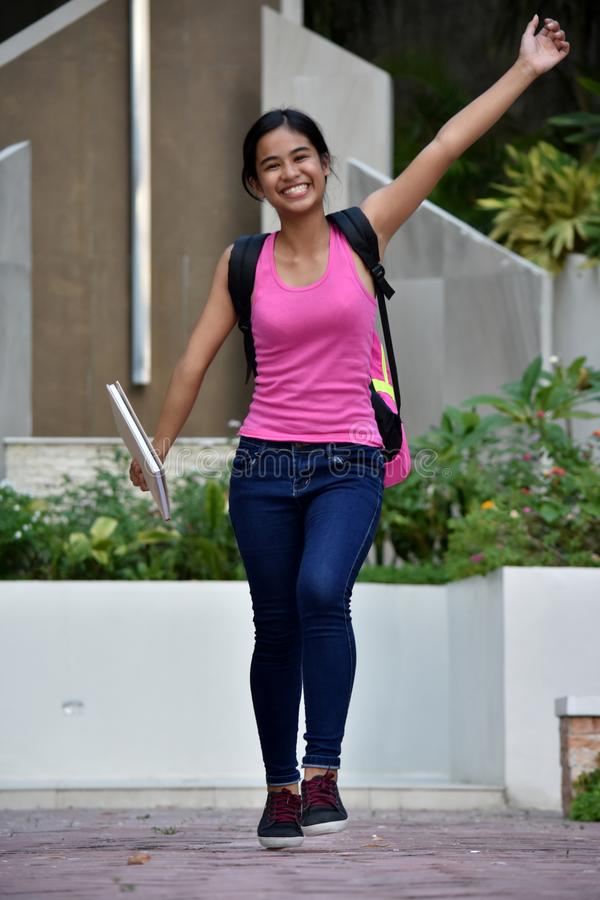 Silly Filipina Girl Student med böcker fotografering för bildbyråer