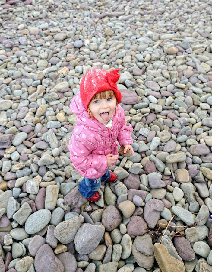 Silly Fun. A little girl sticking her tongue out royalty free stock photos
