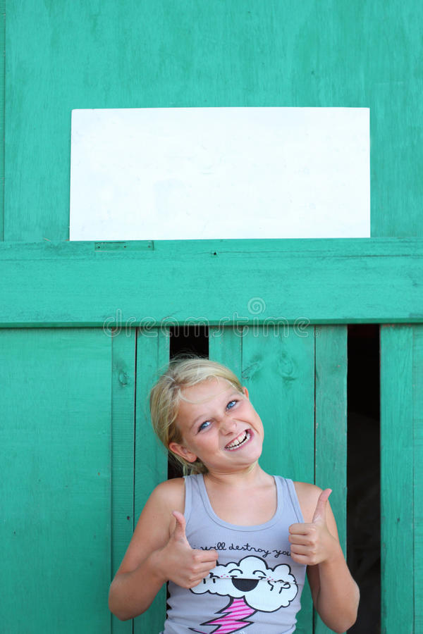 Silly girl with empty sign royalty free stock photo