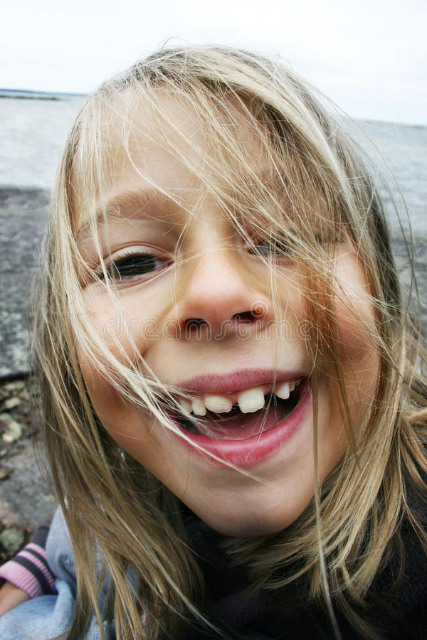 Silly girl showing teeth royalty free stock photo
