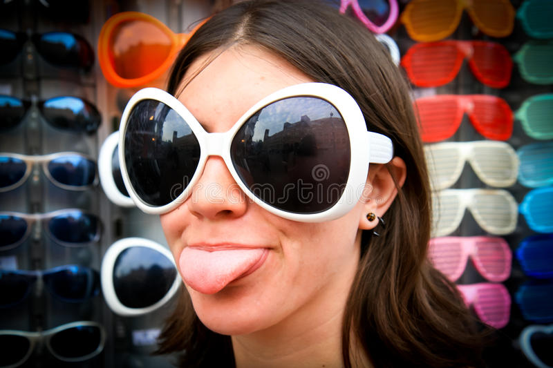 Silly Girl in Sunglasses. A silly girl in large sunglasses stock photo