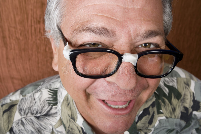 Silly Man with Taped Glasses. Silly Mexican-Italian Man with Taped Corrective Glasses royalty free stock photo