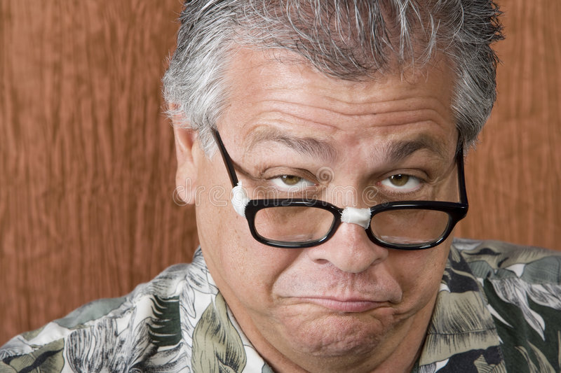 Silly Man with Taped Glasses. Silly Mexican-Italian Man with Taped Corrective Glasses stock image