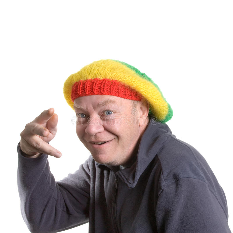 Silly old Man. Wearing rasta bonnet clowning around stock photography