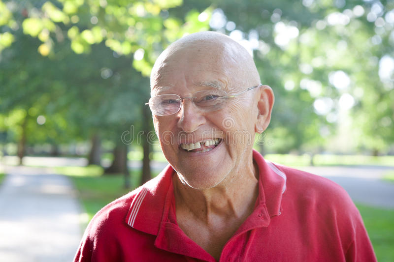Silly Old Man Missing Tooth. A silly old man with a missing tooth stock photography