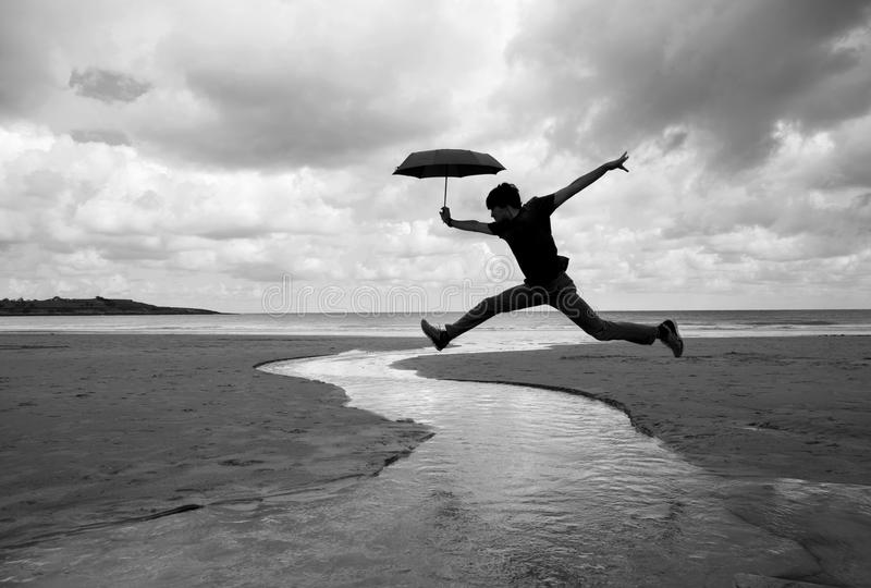 Silly walks on a wet beach stock image